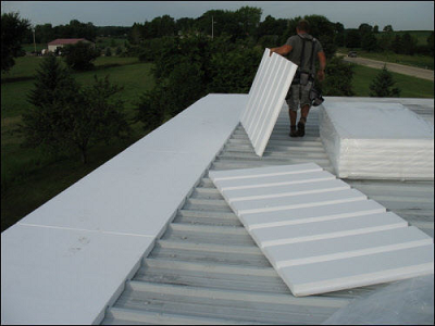 Re-roofing a metal flat roof with TPO outside Madison Wisconsin