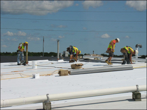 Ixonia WI TPO roofing contractors installing new commercial flat roof